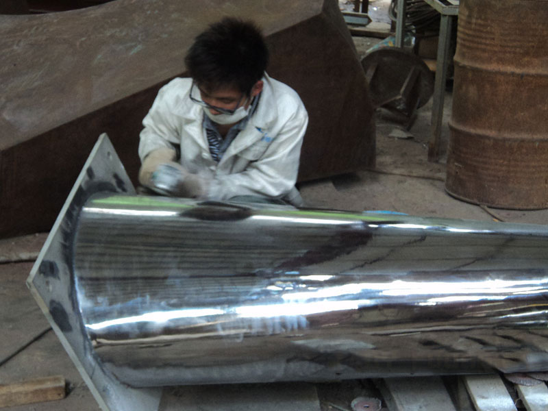 Polishing the Surface of Modern Stainless Steel Sculpture