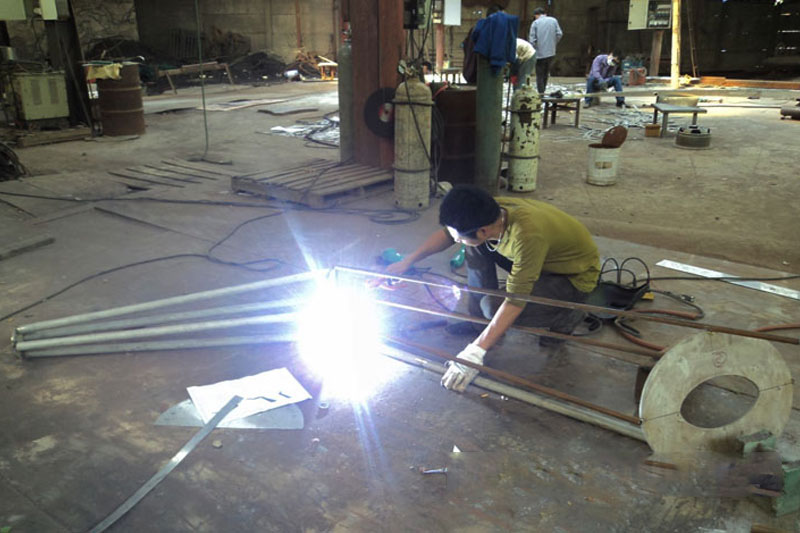 Welding the Pieces of Stainless Steel Sculpture Together