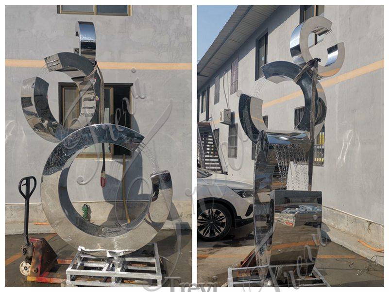metal water fountain sculpture